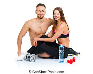 Sport couple - man and woman after fitness exercise with dumbbel