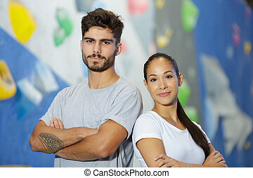 sport couple posing in the gym