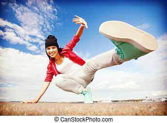 beautiful dancing girl in movement - sport, dancing and...