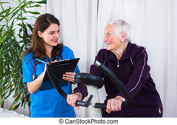 Sport effort tests - Geriatrician taking notes about the...