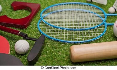 Sport equipment for mini golf, badminton, ping pong and baseball close up. High quality FullHD footage