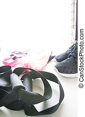 Sport equipment. Sport shoes, Sport bra and sport pants. Copy space