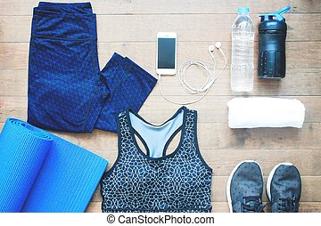 Sport equipments. Sport bra. Smartphone and sport shoes on wood floor, Healthy lifestyle concept