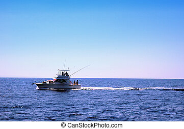 sport fish boat - recreation boat fishing in a  summer day
