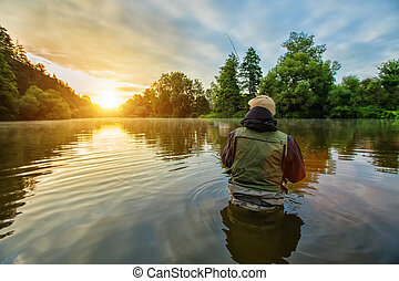 Sport fisherman hunting fish. Outdoor fishing in river -...