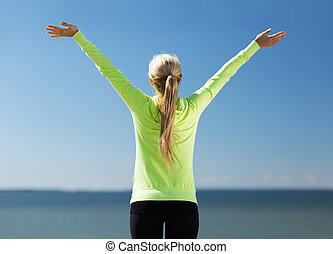 woman doing sports outdoors - sport, fitness, exercise and ...