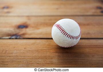 close up of baseball ball on wooden floor