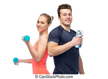 sportive man and woman with dumbbell and water - sport,...