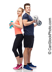 sportive man and woman with dumbbells - sport, fitness,...