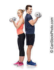 sportive man and woman with dumbbells