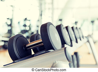 close up of dumbbells in gym - sport, fitness, weightlifting...