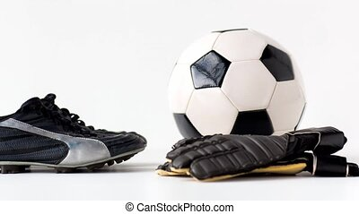soccer ball, boots and gloves on white background - sport, ...