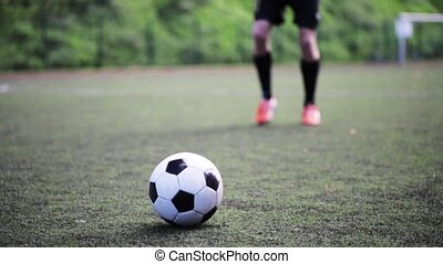 soccer player playing with ball on field