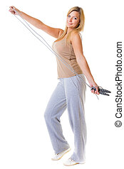 Sport girl fitness woman doing exercise with skip jump rope isolated