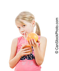 Sport girl with a grapefruit in the hands of a smoothie drink.