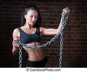 Sport girl with metal chain in hand