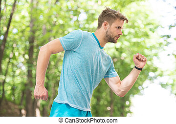 Sport is way of life. Sportsman lifestyle. Handsome athlete in park. Male beauty. Sport wellbeing and self care. Handsome man sporty outfit look confident. Guy handsome bearded face. Sport coach