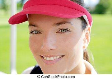 sport kvinna, närbild, ansikte, sol hjämgaller, mössa