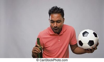 indian man or football fan with soccer ball - sport, leisure...