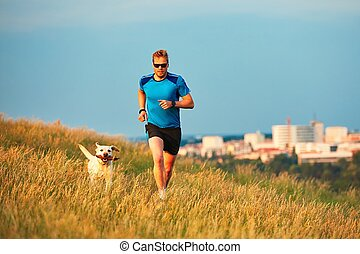 Sport lifestyle with dog. Athletic young man and labrador...