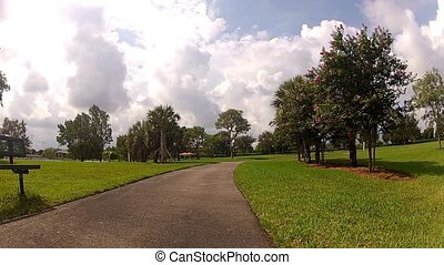 sport man in white running in park