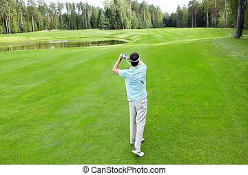 Sport - Man plays golf on the golf course