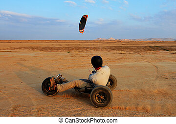 Sport Photos - Paragliding - A paraglider with a trike buggy...