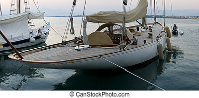 a sailing boat in the marina of nafplion in greece