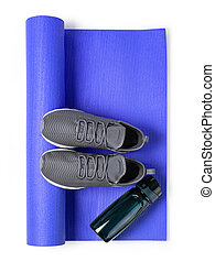 Sport shoes and yoga mat Isolated on white background