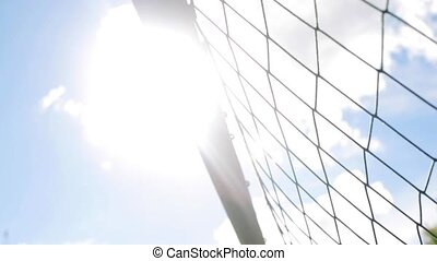 ball flying into football goal net