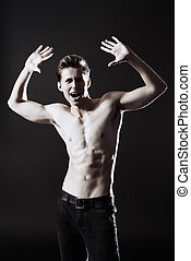 sport success - Handsome shirtless male model posing at...