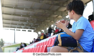 Sport supporter watching the game - Child Watching Football...