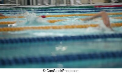 Sport swimming tense moment of competition tracking shot