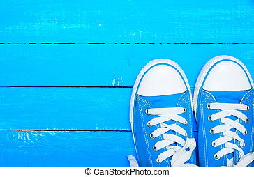 sport textile blue sneakers with white laces
