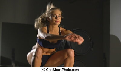 Sport. View of beautiful girl jumping in gym