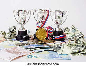 Sport winning concept: three cups among diverse currencies...