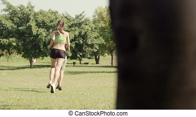 Sport with two young women jogging