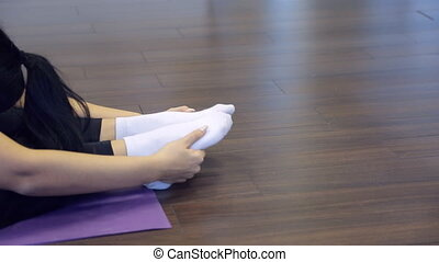 Sport woman doing stretching exercises inside fitness studio