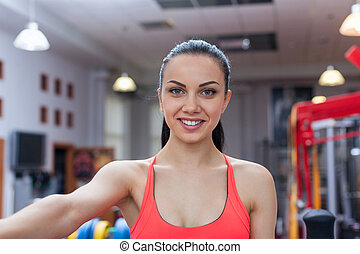 Sport woman exercising gym, fitness center - sport woman...