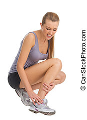 Sport woman feeling pain in her ankle. Isolate don white