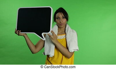 Sport woman isolated green screen upset with blank sign