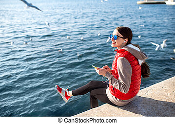 Sport woman on the beach - Young woman dressed in sportswear...