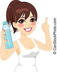 Sport Woman Showing Bottle - Beautiful sport brunette woman...