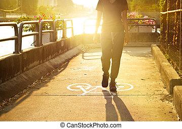 sport woman walk on symbol bike lane in vibrant sunrise,...