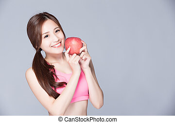 sport woman with an apple