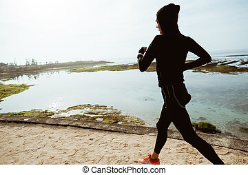 sport woman with head scarf running
