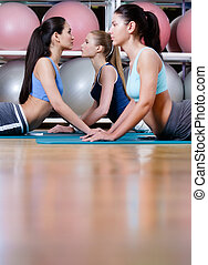 Sport women doing stretching fitness exercise