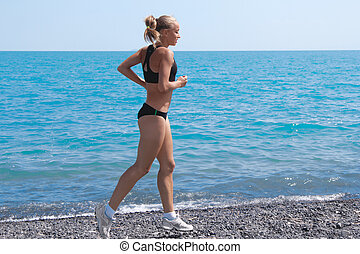 sport women running sea beach at summer