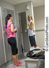 Sport women talking in changing room