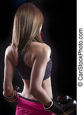 sport young woman boxing gloves, face of fitness girl studio shot over black background